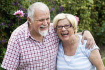 10-08-2009 - A disabled man shares a laugh with his wife. The man has had his leg amputated due to poor blood circulation. © Paul Box