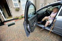 10-08-2009 - A disabled man gets in the passenger seat of his car. The man has had his leg amputated due to poor blood circulation. © Paul Box