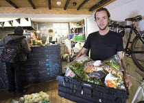 17-10-2014 - The Bristol Skipchen: a Real Junk Food Project. A community food waste cafe operating on a pay-as-you-feel basis. Staffed entirely by volunteers the serve intercepted waste food that would otherwise h... © Paul Box