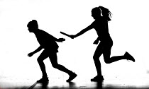 29-07-2014 - Passing the baton on. Silhouettes of pupils doing sport at Priory school, Weston Super Mare © Paul Box