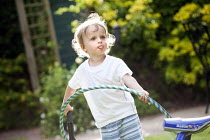 17-06-2014 - A toddler plays with a hula hoop, Stratford Upon Avon © Paul Box
