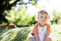 06-07-2014 - A toddler plays in a garden, Pembrokeshire, Wales © Paul Box