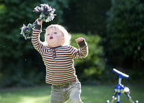 25-05-2014 - A toddler plays in a garden, Stratford Upon Avon. © Paul Box