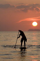 27-09-2008 - A stand up paddle surfer at Newgale beach in the sunset, Pembrokeshire. © Paul Box