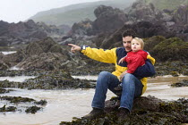 30-08-2009 - A young boy and his father at Freshwater West beach in Pembrokeshire. Wales © Paul Box