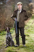 16-03-2009 - A shooting enthusiast with his gun dog and double barreled shotgun, Exmoor. © Paul Box