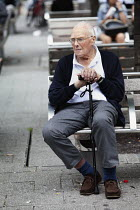 03-07-2011 - An elderly man sitting alone on a bench in the shopping precinct, Southampton. © Paul Box