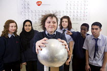 23-03-2010 - Pupils using the Van de Graaff generator in a science lesson, the static electricity makes the hair stand on end. Bristol City Academy. © Paul Box