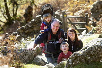 28-10-2010 - A family hiking up the Cader Idris or Cadair Idris mountain, situated in the Snowdonia National Park, North Wales. © Paul Box