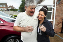 31-08-2010 - A bride and her father celebrating with a glass of champagne before the wedding, Derby. © Paul Box
