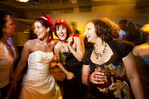 31-08-2010 - A bride dancing at her wedding reception, Derby. © Paul Box