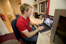 13-12-2005 - Student Housing by UNITE. Purpose built student housing. Bristol. A student using his laptop. © Paul Box