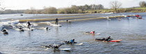21-03-2015 - Surfers on The Severn bore tidal wave, on one of the largest tides of the year. Gloucestershire. © Paul Box