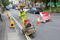 06-17-2015 - Residents protesting at new resident parking scheme, St Pauls, Bristol. Sub contractors painting double yellow lines. No parking cones on the street © Paul Box