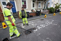 06-17-2015 - Residents protesting at new resident parking scheme, St Pauls, Bristol. Sub contractors painting double yellow lines. © Paul Box