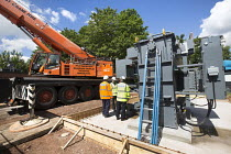 23-06-2015 - Electrical engineers installing new transformers at substation, Clifton, Bristol © Paul Box
