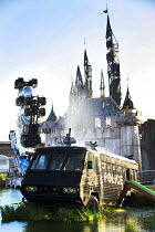 27-08-2015 - Dismaland a parody of Disneyland theme park by Banksy, Weston Super Mare. Police vehicle, fairytale castle Big Rig Jig, an artwork by Mike Ross at the Bemusement Park. © Paul Box