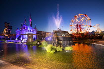 27-08-2015 - Dismaland a parody of Disneyland theme park by Banksy, Weston Super Mare. Giant Pin Wheel, Fairytale Cinderella castle, Big Rig Jig by Mike Ross Water Cannon Creek, Police armour plated riot control v... © Paul Box