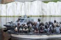 07-09-2015 - Dismaland a parody of Disneyland theme park by Banksy, Weston Super Mare. A drive a boat pond with boats full of refugees at the Bemusement Park. © Paul Box