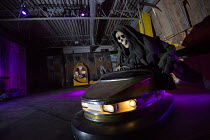 07-09-2015 - Dismaland a parody of Disneyland theme park by Banksy, Weston Super Mare. Death, The grim reaper riding the dodgems at the Bemusement Park. © Paul Box