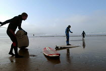 12-02-2004 - Father goes surfing with his sons, Woolacombe, Devon © Paul Box