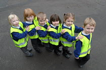 02-02-2004 - Children from a Gloucestershire primary school walking to school on the walking bus to replace the school run, and increase road safety for children walking to school. © Paul Box