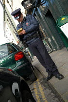 03-03-2004 - Parking attendant supervisor writes a parking ticket , Bristol © Paul Box