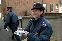 03-03-2004 - Woman parking attendant laughing with fellow worker, Bristol © Paul Box