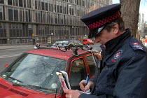 03-03-2004 - A newly trained parking attendant writes a parking ticket , Bristol © Paul Box