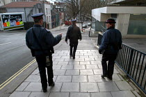 03-03-2004 - Parking attendants walking to have a tea break , Bristol © Paul Box