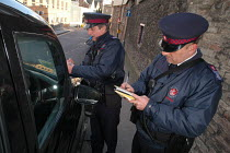 03-03-2004 - Parking attendant supervisor writes a parking ticket for a taxi with newly trained attendant, Bristol © Paul Box