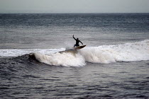 01-03-2004 - A surfer surfing, north coast of Devon in the winter © Paul Box