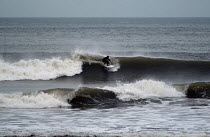01-03-2004 - A surfer , surfing on the north coast of Devon in the winter. © Paul Box