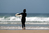 01-03-2004 - Girls learning to surf, Freshwater west, Pembrokeshire. © Paul Box