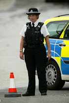 10-06-2004 - Police officer attends a bust water main in Bristol © Paul Box