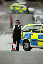 10-06-2004 - Police officer attends a bust water main in Bristol, the road has been closed. © Paul Box