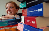 02-08-2004 - A Trainee accountant with her books. © Paul Box