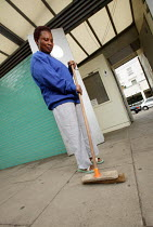 07-07-2004 - A toilet attendant cleaning, London © Paul Box