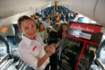20-11-2004 - Ladbrokes bookies who now have a gambling service on airplanes. © Paul Box