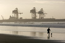 05-12-2005 - Runner on the beach in Port Talbot, Wales. © Paul Box