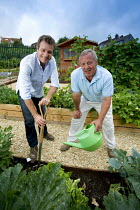 15-12-2005 - Chris Beardshaw award winning gardener and tv presenter with the site manager on a new allotment project. Bristol © Paul Box