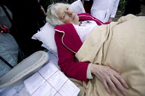 07-01-2006 - Bridgnorth Hospital, a community hospital. An elderly patient is pushed through the streets Bridgenorth' at the health service cuts protest . The hospital faces closure as the Shropshire County Primar... © Paul Box