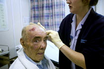 07-01-2006 - Bridgnorth Hospital, a community hospital.A nurse attends an injured patient. The hospital faces closure as the Shropshire County Primary Care Trust needs to make cuts. © Paul Box