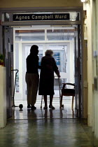 07-01-2006 - Bridgnorth Hospital, a community hospital. A Patient is helped walk down the hospital corridor. The hospital faces closure as the Shropshire County Primary Care Trust needs to make cuts. © Paul Box