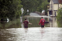 21-07-2007 - Boys go surfing in flood water after the river Avon burst its banks, Welford On Avon, near Stratford upon avon, Warwickshire. © Paul Box