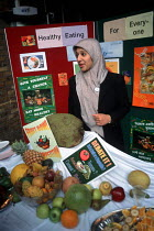 20-05-2003 - A Royal London Hospital nutritionist runs a healthy eating stall at a multicultural festival in Whitechapel, London © Philip Wolmuth