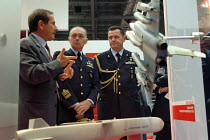09-09-2003 - Italian military personnel at the MBDA Missile Systems stand at the Defence Systems and Equipment International Exhibition, Docklands, London 9/9/03. © Philip Wolmuth