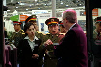 09-09-2003 - A Chinese Army Lieutenant General inspects a vehicle at the Smiths Aerospace stand at the Defence Systems and Equipment International Exhibition, Docklands, London 9/9/03. © Philip Wolmuth