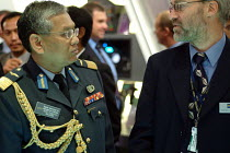 09-09-2003 - A Malaysian Army Brigadier General inspects the Flexible Battlefield Command and Information Systems stand at the Defence Systems and Equipment International Exhibition, Docklands, London 9/9/03. © Philip Wolmuth
