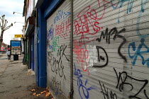 12-11-2003 - Graffiti on a shopfront, Cricklewood, Brent, London. © Philip Wolmuth